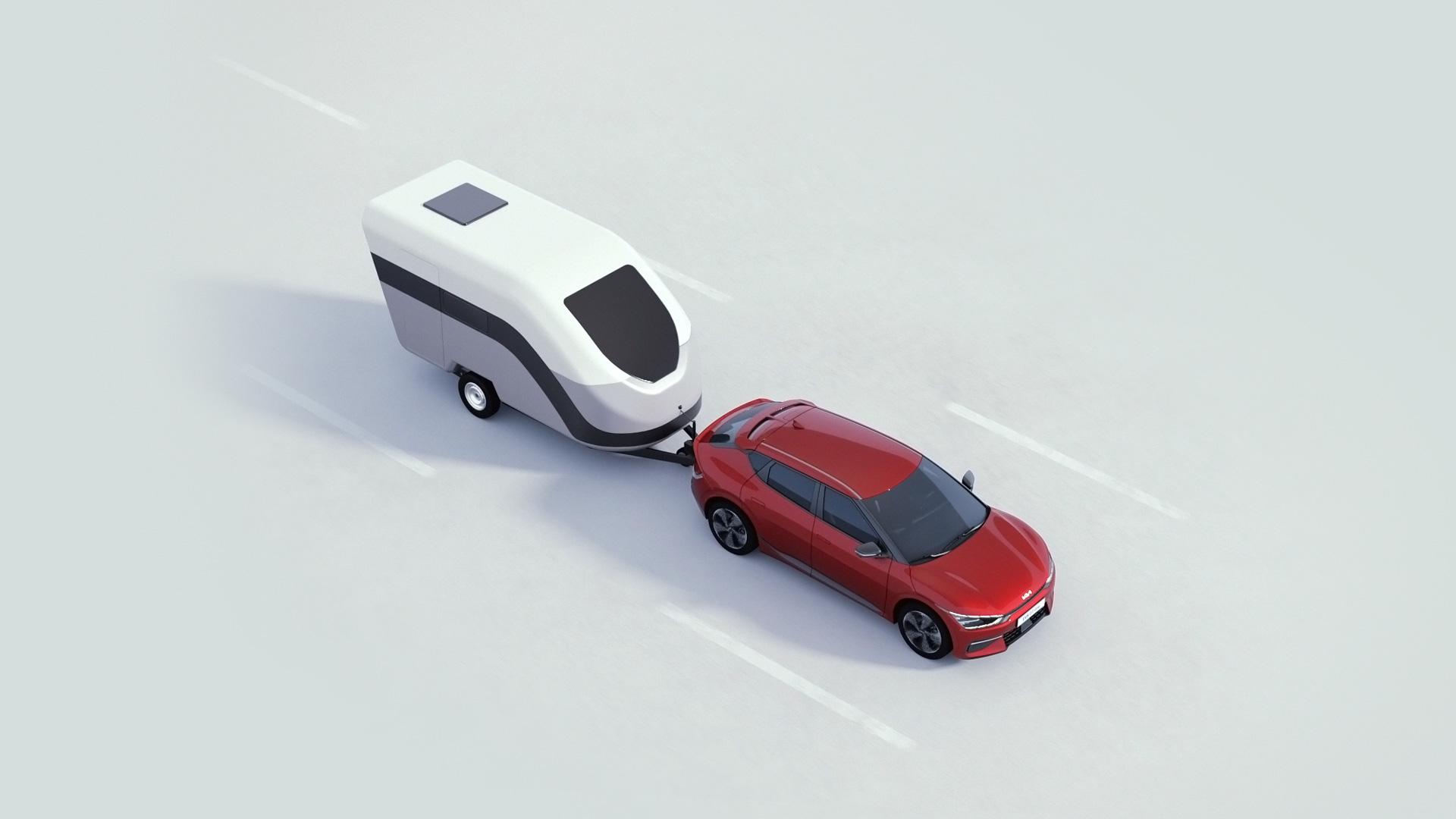 Kia EV6 in rot auf Strasse mit Hänger